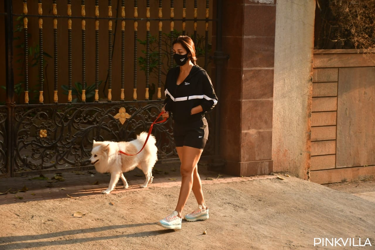 Malaika Arora soaks in the morning sun as she kicks off her day with a stroll with pet Casper; PHOTOS