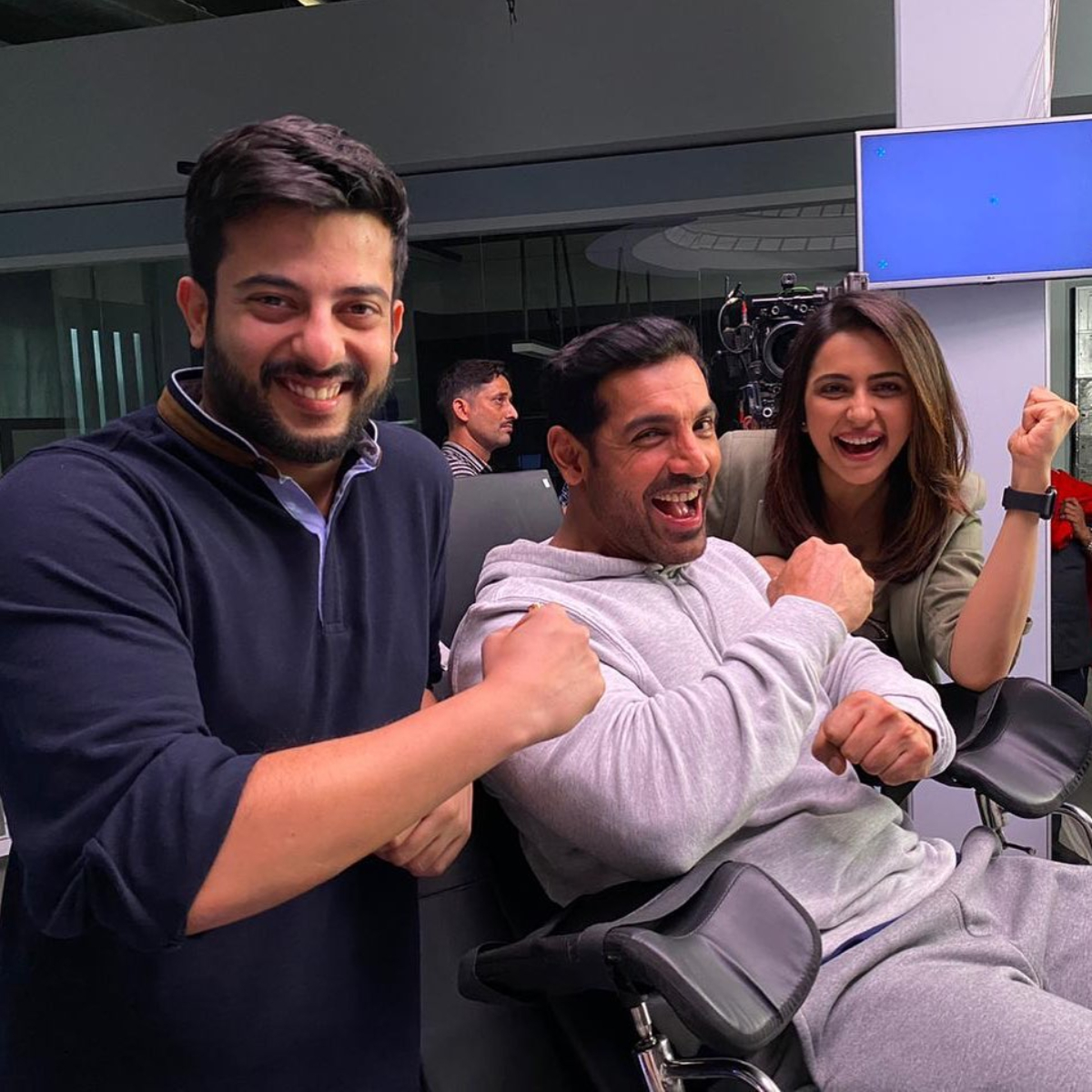 Attack: John Abraham and Rakul Preet pose for a happy picture while shooting on the sets