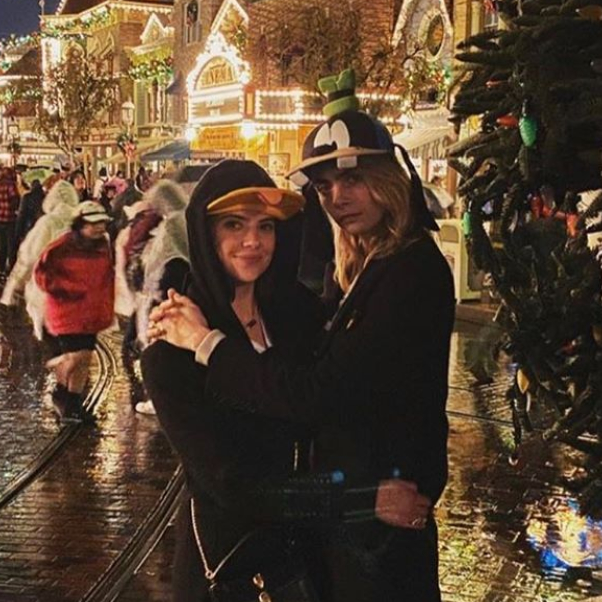 Cara Delevingne And Ashley Benson Cuddle Up During A Family Trip To Disneyland See Photos Pinkvilla