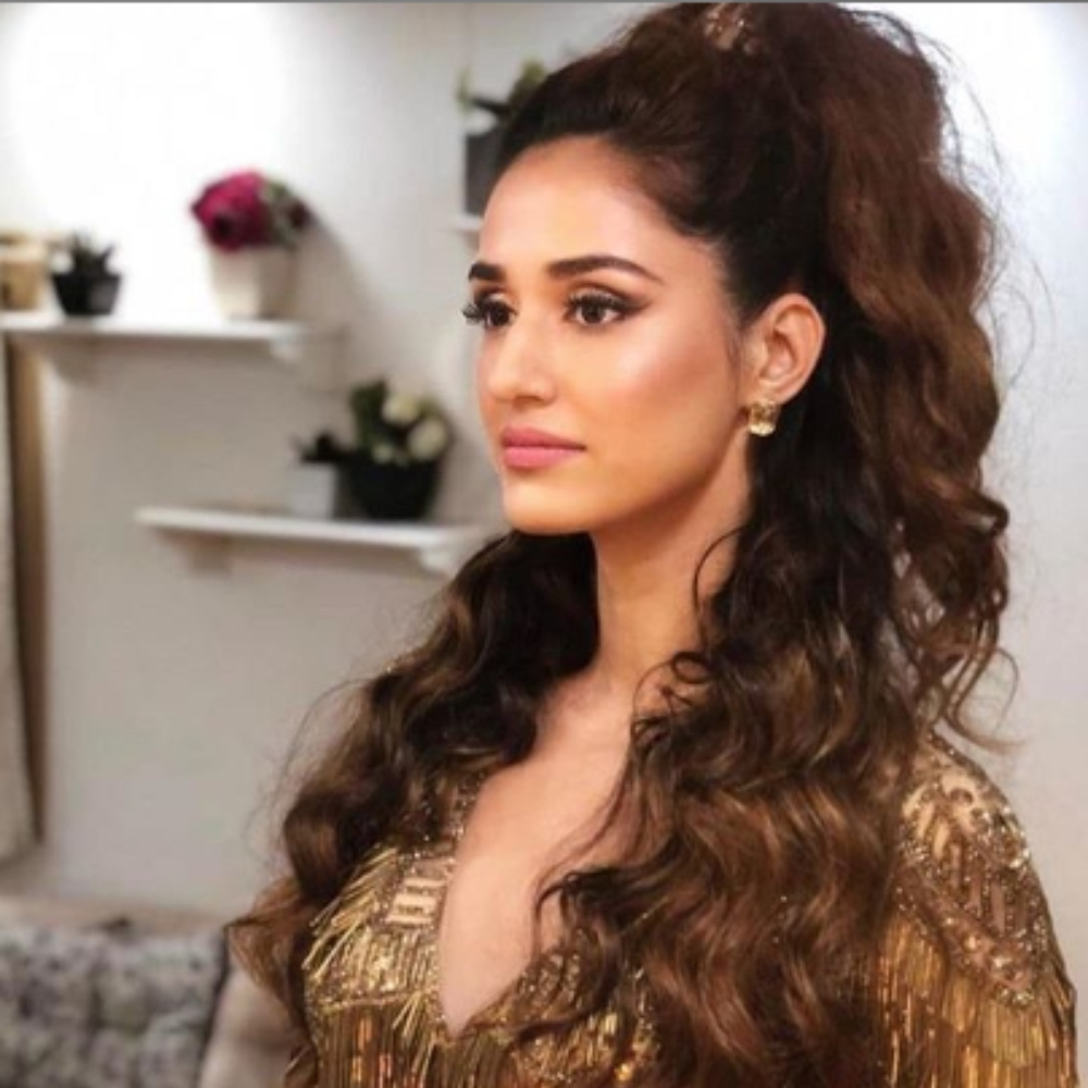Disha Patani dazzles in a shimmery golden outfit as she strikes a pose for the camera; View PICS