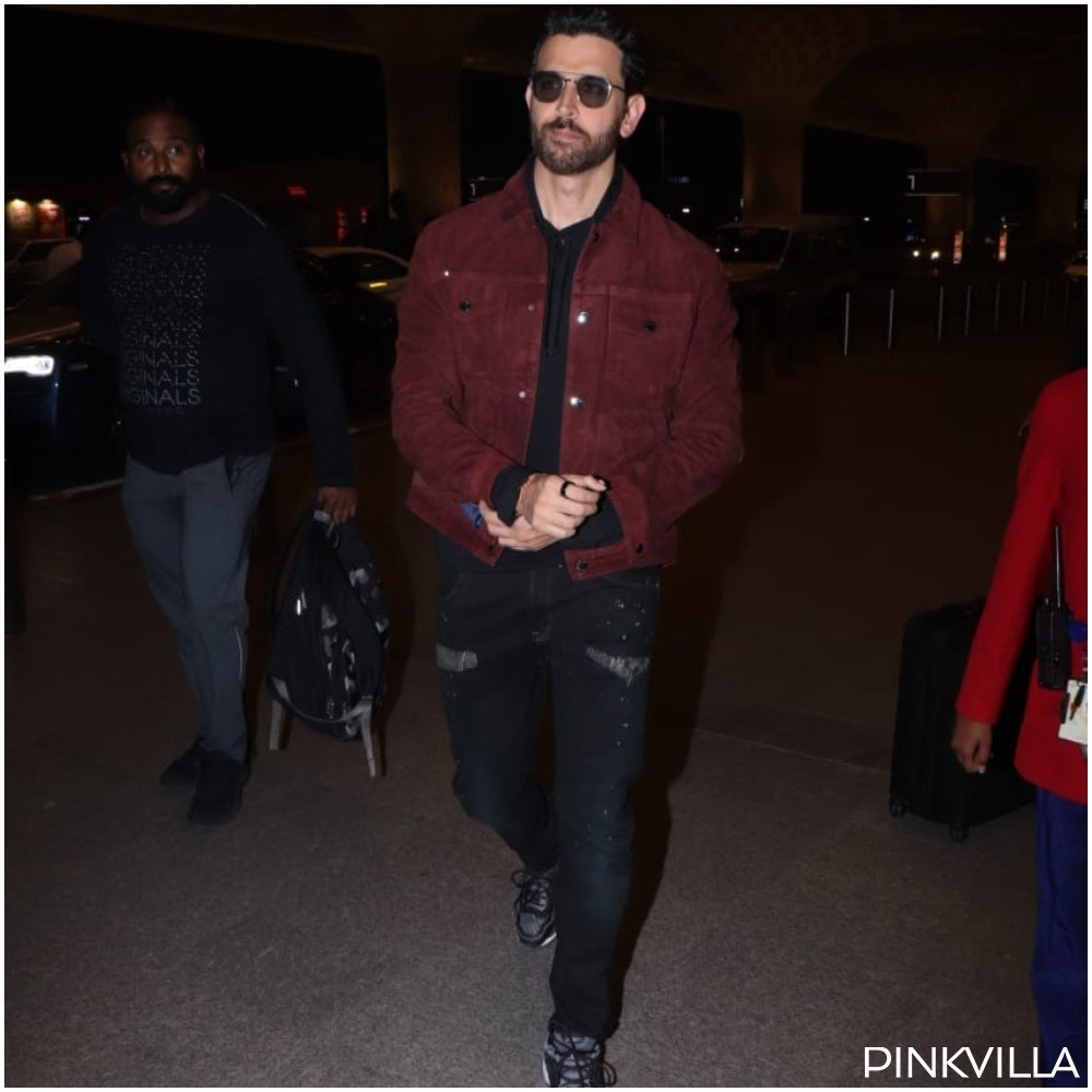 PHOTOS: Hrithik Roshan sports an all black look with a cool jacket on his shoulder for his flight