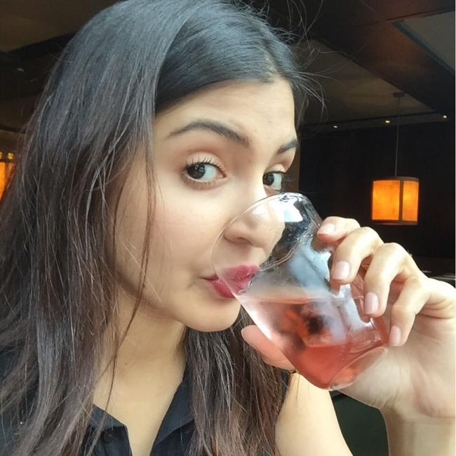 Image result for anushka sharma drinking water