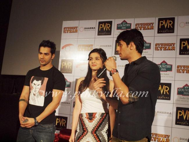 Siddharth speaks as Alia and Varun look on