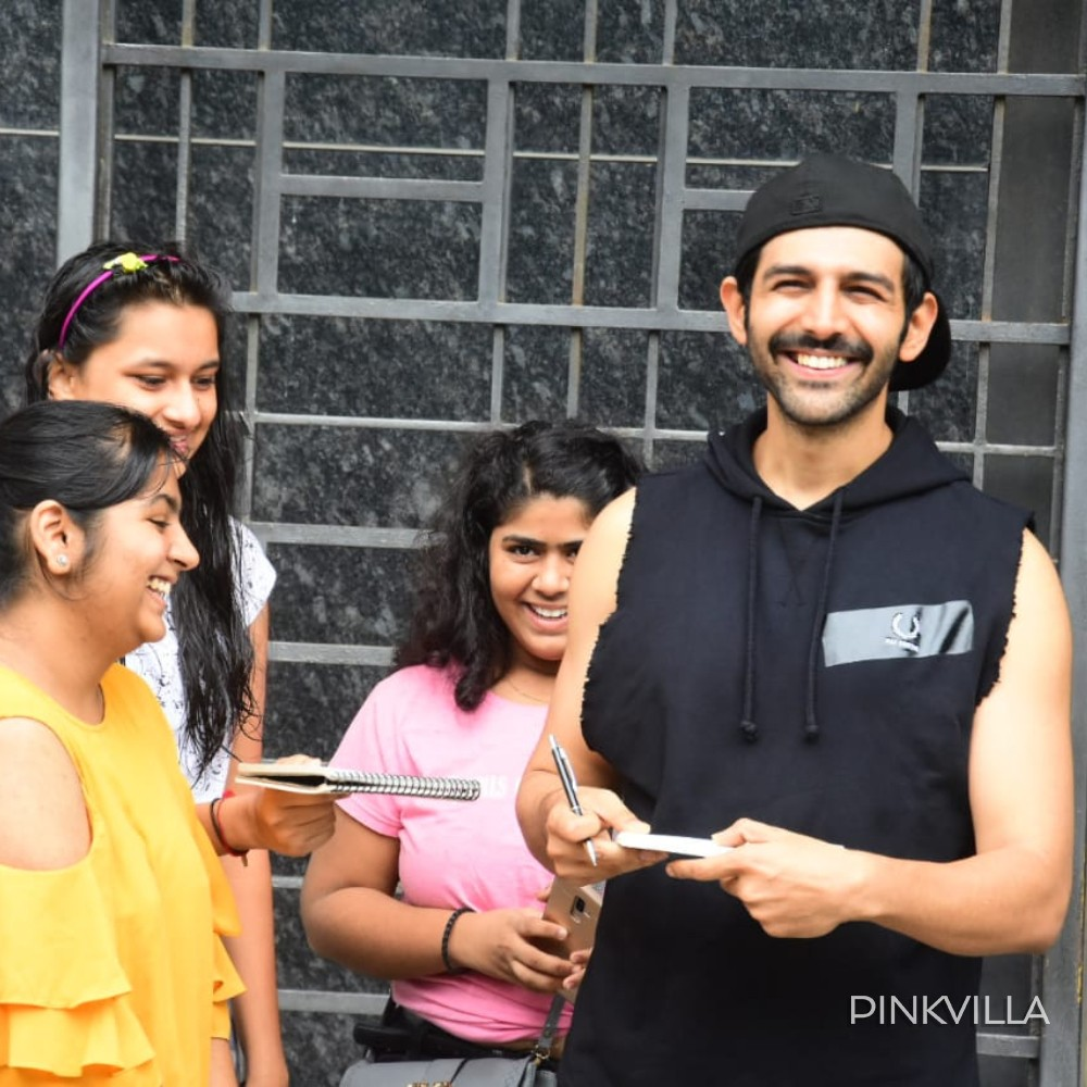 PHOTOS: Kartik Aaryan is all smiles as he gets captured while signing autographs for fans