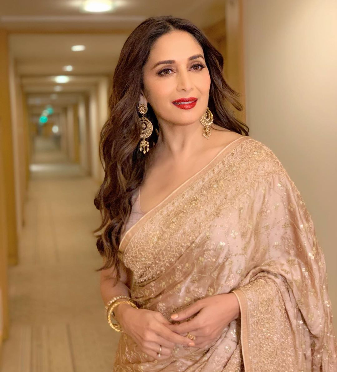 Madhuri Dixit looks sensational & makes hearts go dhak dhak in a gold saree perfect for the festive season