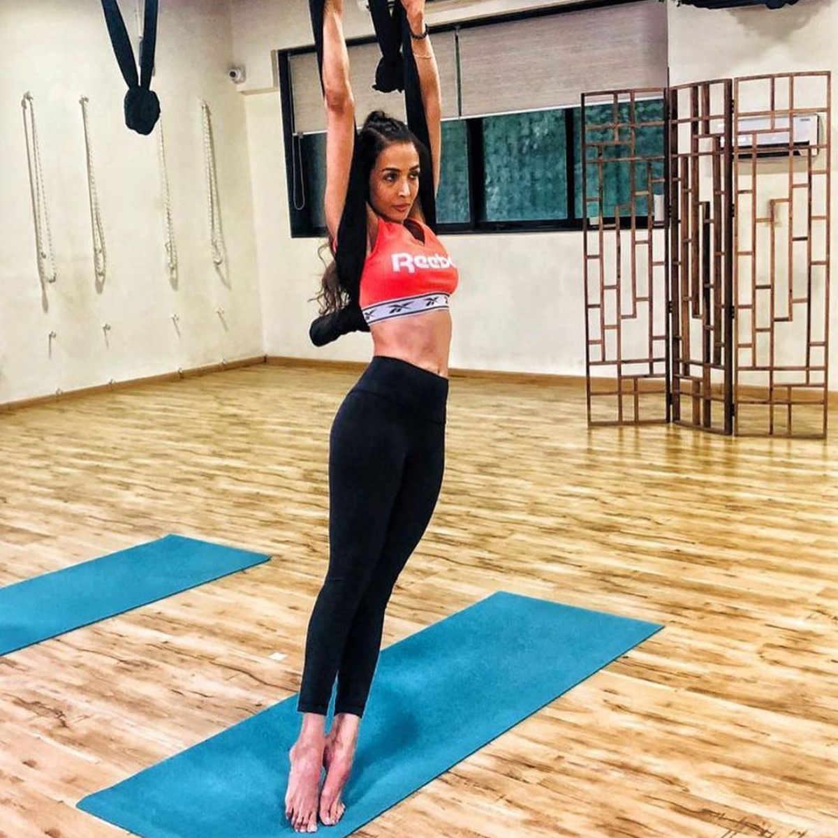 PHOTOS: Malaika Arora stretches her way into a boring Monday motivation & Sonam Kapoor likes it; Check it out