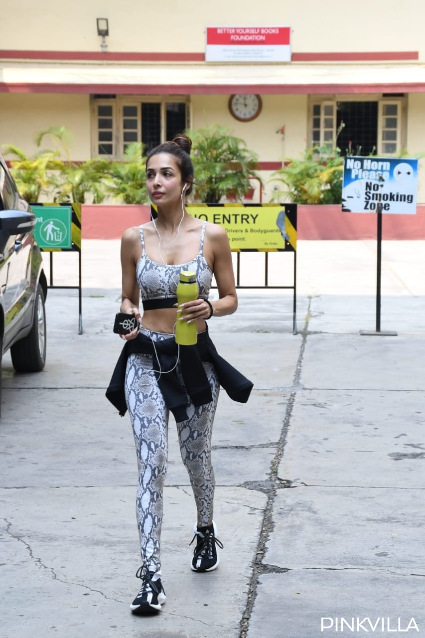 PHOTOS: Malaika Arora shows off her toned midriff as she sweats it out at the gym