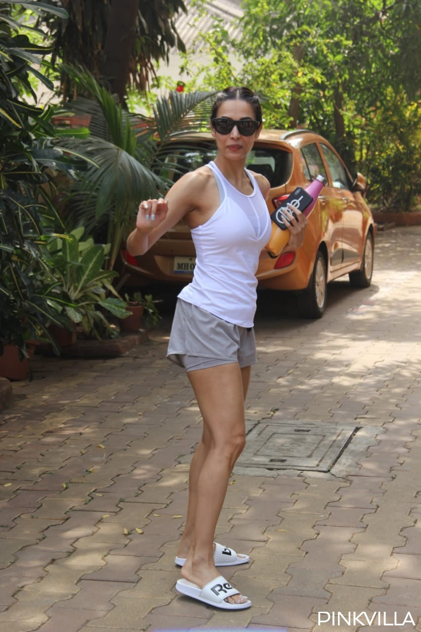 PHOTOS: Malaika Arora dashes into the weekend in mini shorts & tank top as she hits the gym