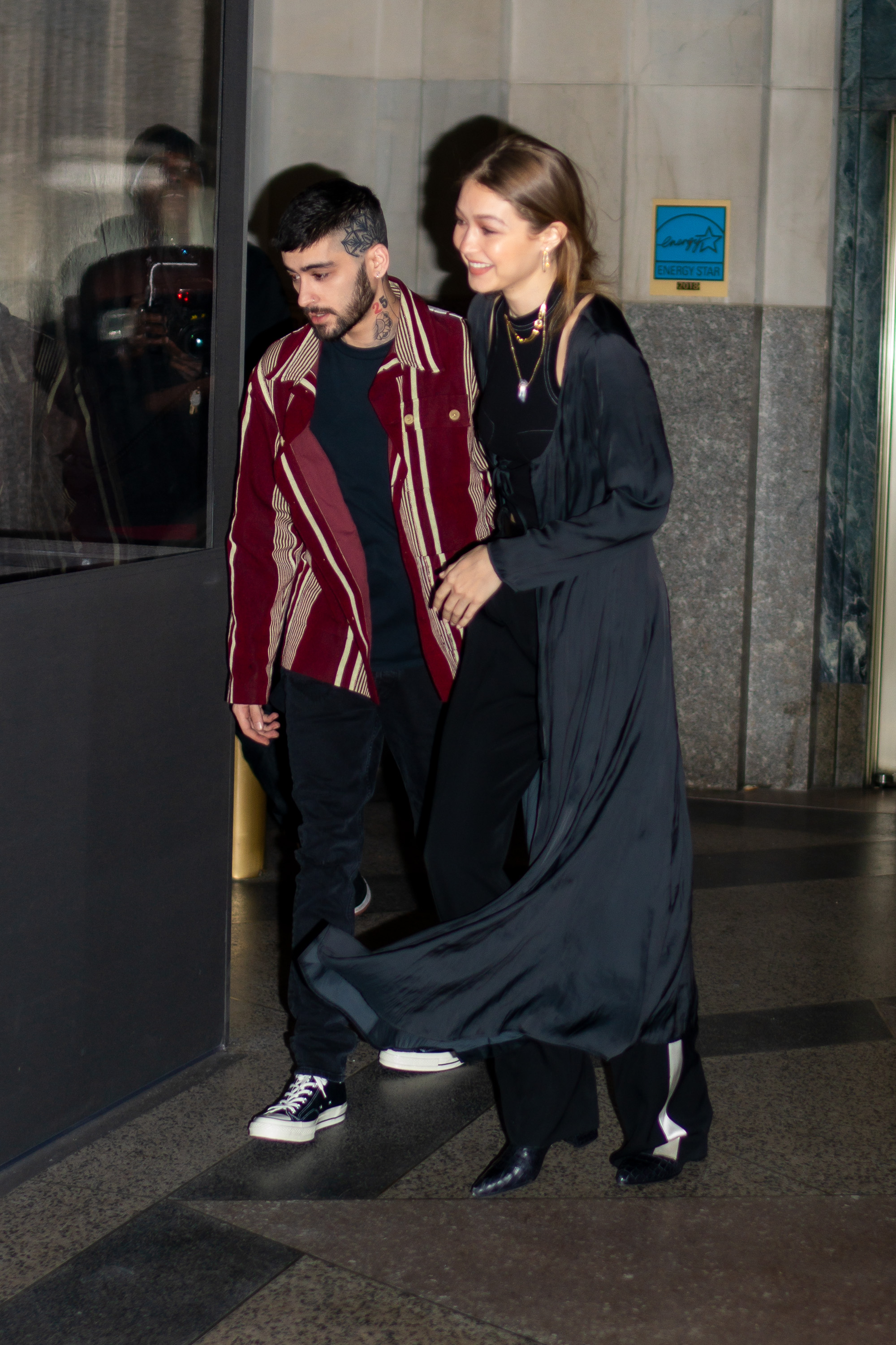 PHOTOS: Zayn Malik and Gigi Hadid can't keep their hands off each other as they enjoy date night in NYC