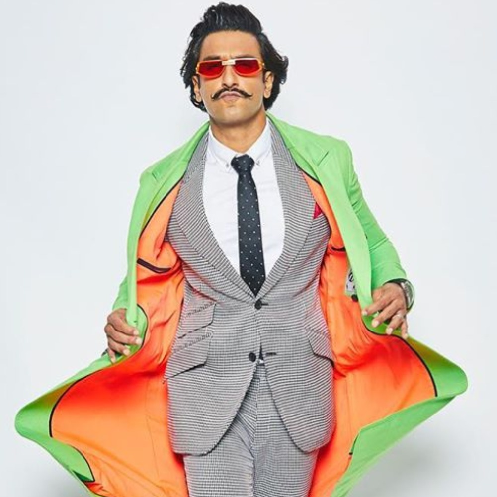 PICS: Ranveer Singh rocks a suit with a pop of neon; Deepika Padukone wants to know where he's going?