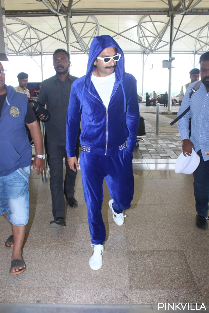 Pics: Ranveer Singh drives away all 'blues' as he makes a striking appearance in velvet track suit at airport