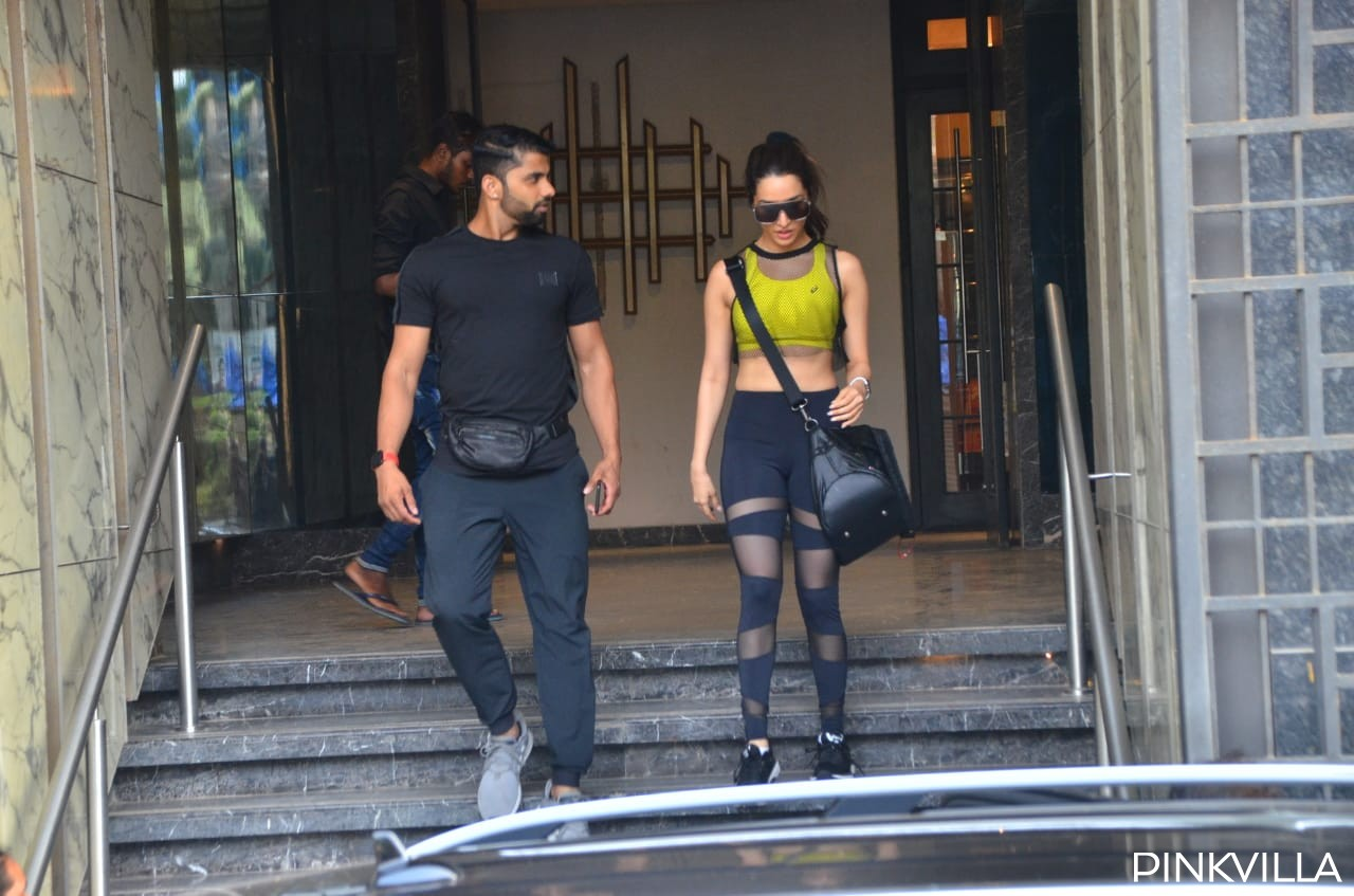 PHOTOS: Shraddha Kapoor shows off her toned midriff in a neon top and tights as she steps out of the gym