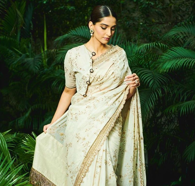 Sonam Kapoor Ahuja looks ethereal in an ivory gold saree & concept blouse by Sabyasachi perfect for Diwali