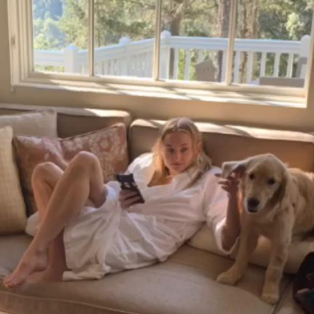 Game of Thrones star Sophie Turner soaks up the sun in her bathrobe as she pets her dog; Check it out