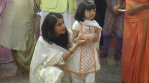 Aishwarya Rai teaches little Aardhya Bachchan how to pray at Durga Puja