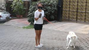 Malaika Arora takes her dog for a leisure walk, requests paps to maintain a safe distance as they click her