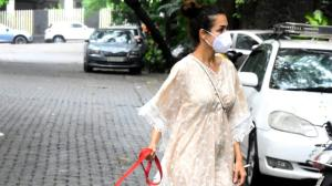 PHOTOS: Malaika Arora keeps it chic and stylish as she steps out with her furry friend for an evening stroll