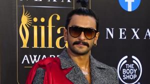 Ranveer Singh makes an outlandish yet eccentric entry in sunglasses, high ponytail and draped suit for IIFA