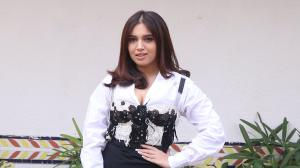 Spotted! Bhumi Pednekar pairs a classic white shirt with a corset and a slit pencil skirt