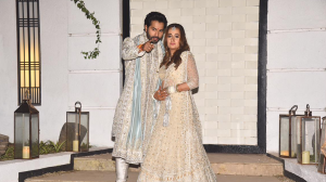 Varun Dhawan gets protective about wifey Natasha on their first appearance as husband & wife!