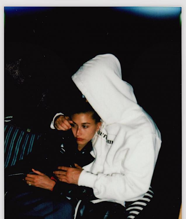 Hailey Baldwin cuddles close to hubby Justin Bieber in this loved up photo