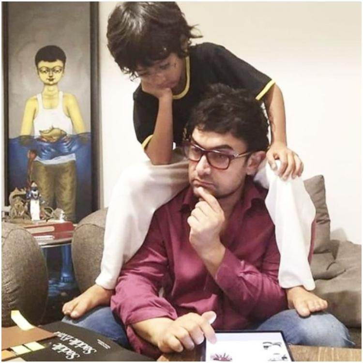 Aamir Khan is busy working and son Azad is giving him company as he sits on his shoulders;  See Pic