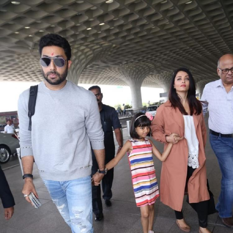 PHOTOS: Aishwarya Rai Bachchan, Abhishek Bachchan & their lil munchkin Aaradhya leave for a vacation in style