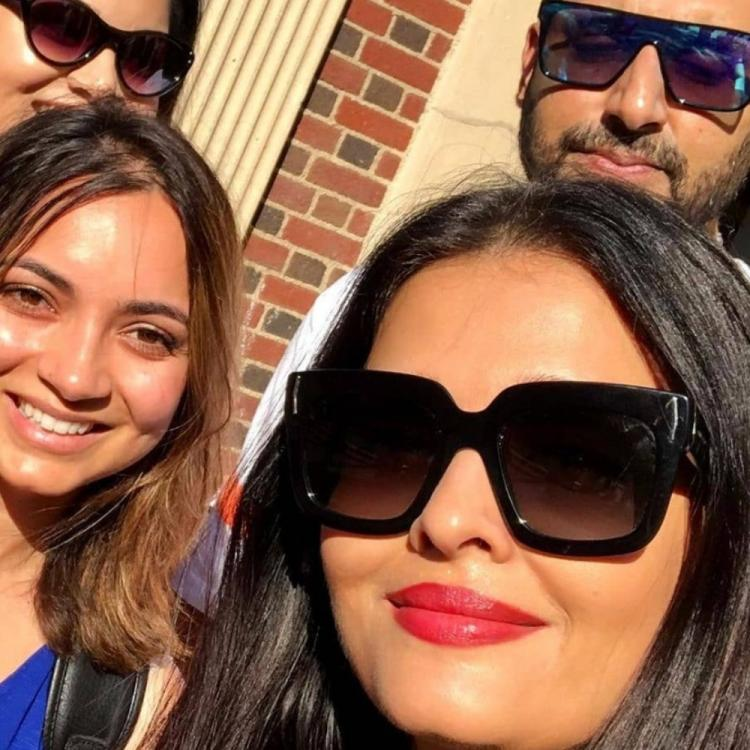 Aishwarya Rai Bachchan & Abhishek Bachchan soak in the sun in NYC as they pose with their fans; See Pic