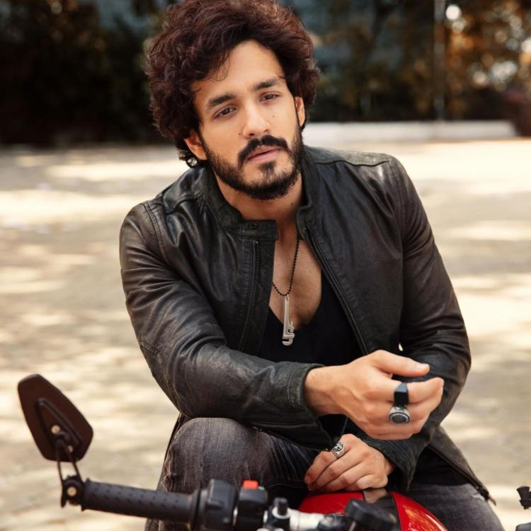Akhil Akkineni has his fans swooning over his rugged look as he poses for a PHOTO on his bike
