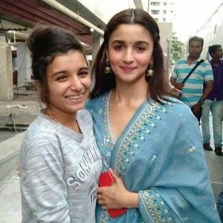 Alia Bhatt is all smiles in this throwback picture while posing with a fan during Kalank promotions