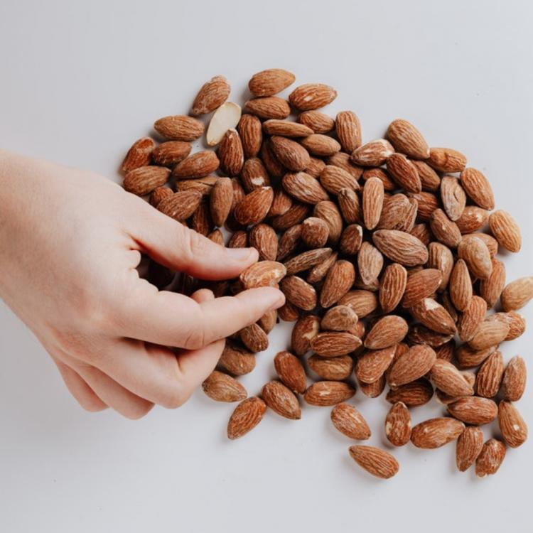 Almond Oil is the ONE kitchen ingredient that solves both skin and hair woes without much effort