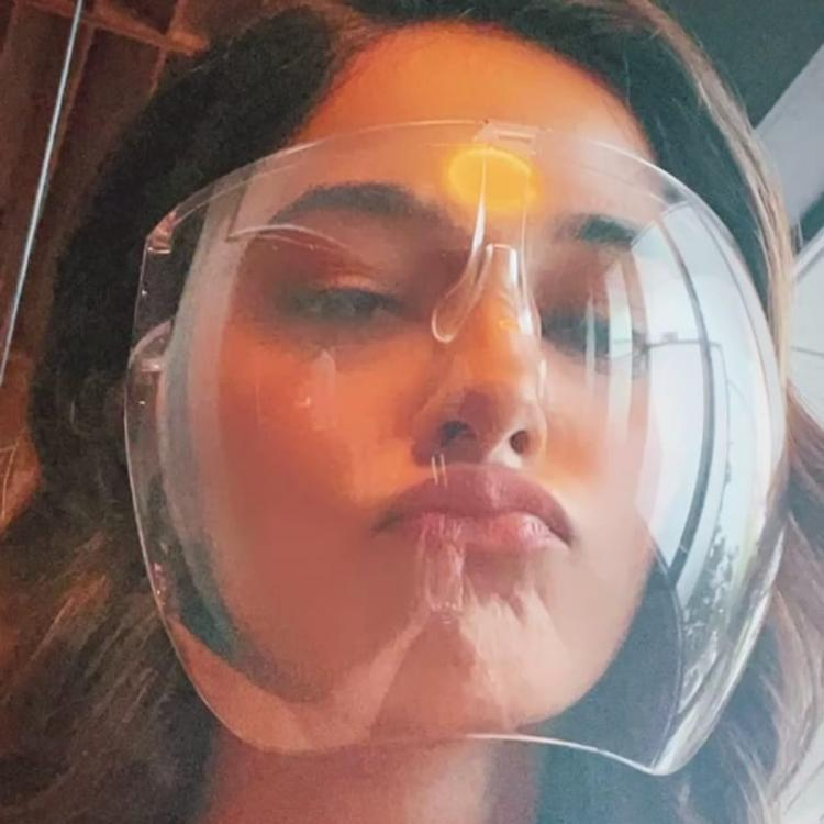 PIC: Ananya Panday wants some 'space' as she pokes fun at herself while donning a face shield outdoors
