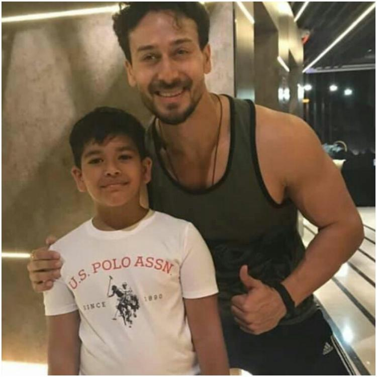 Baaghi 3 star Tiger Shroff is all smiles as he gives his little fan a thumbs up and poses with him; See Pic