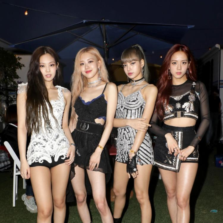 BLACKPINK posing at the concert.