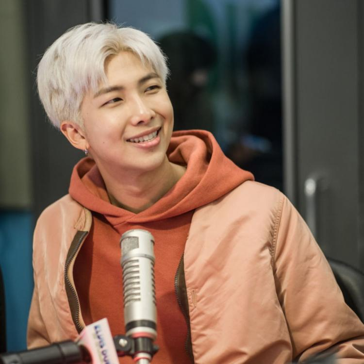 BTS' RM smiling in an interview