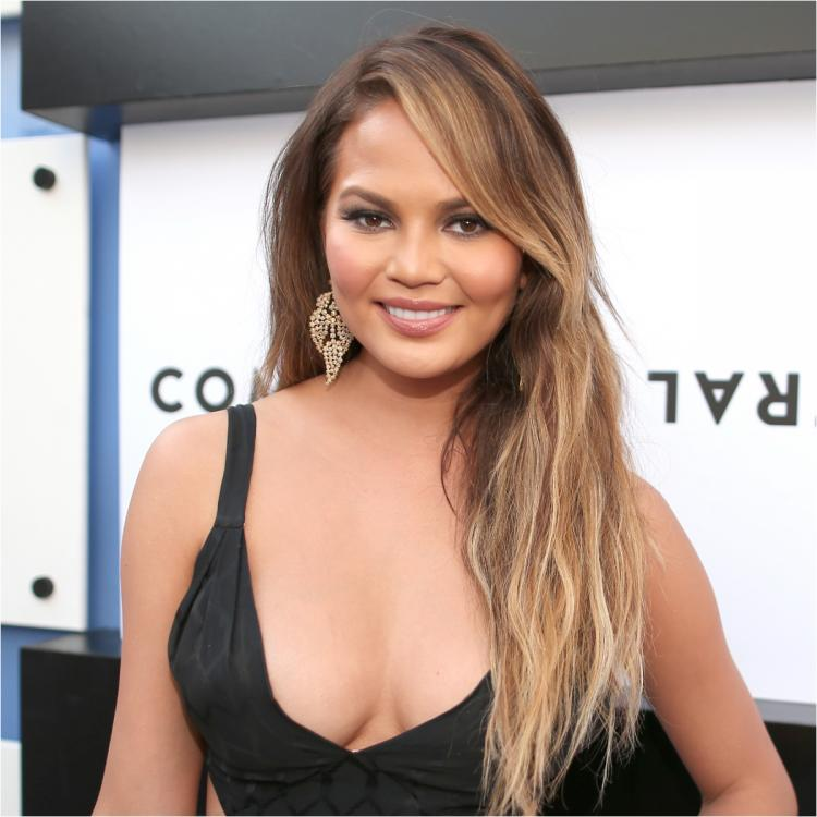 Chrissy Teigen gets ear pierced after consulting Twitter fans: Too old for a little diamond? Please be honest