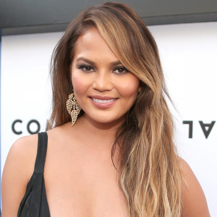 Chrissy Teigen responds to a troll who called her 'classless'