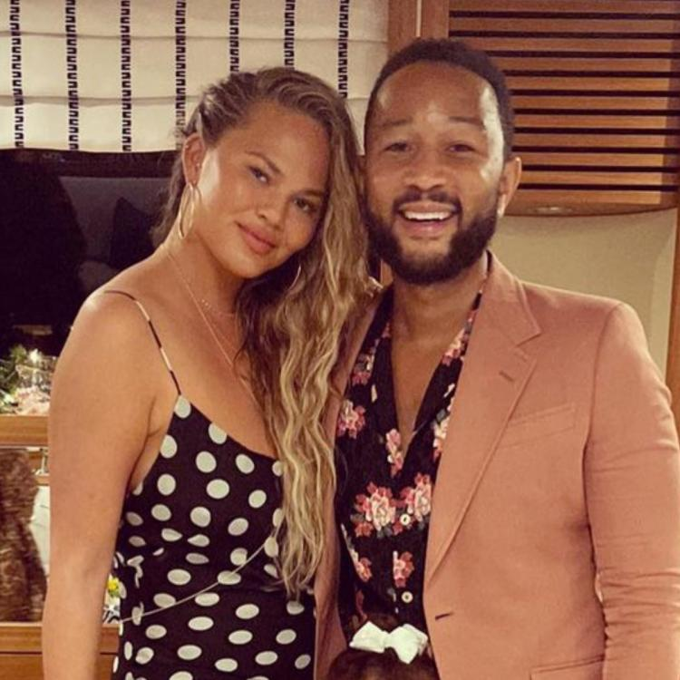 Chrissy Teigen calls out husband John Legend for some credit as he wins this 3rd Grammy for Best R&B Album.