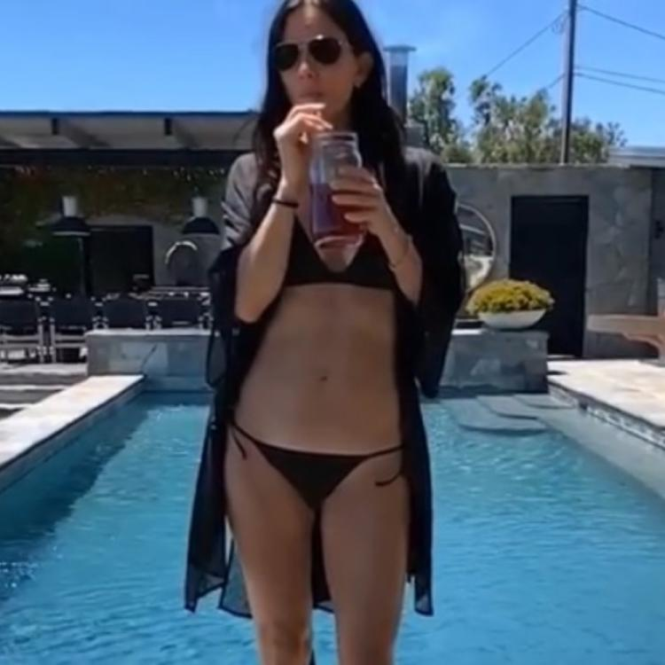 Friends star Courteney Cox has us hooked on to her gravity defying poolside video in a black bikini; Watch