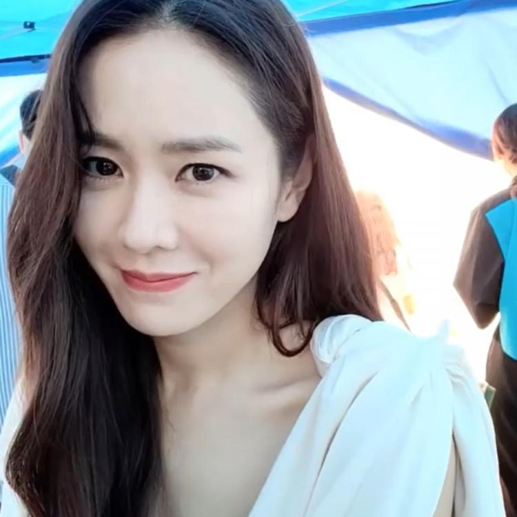 Crash Landing On You star Son Ye Jin is a vision in white as she cannot keep her hands off her hair