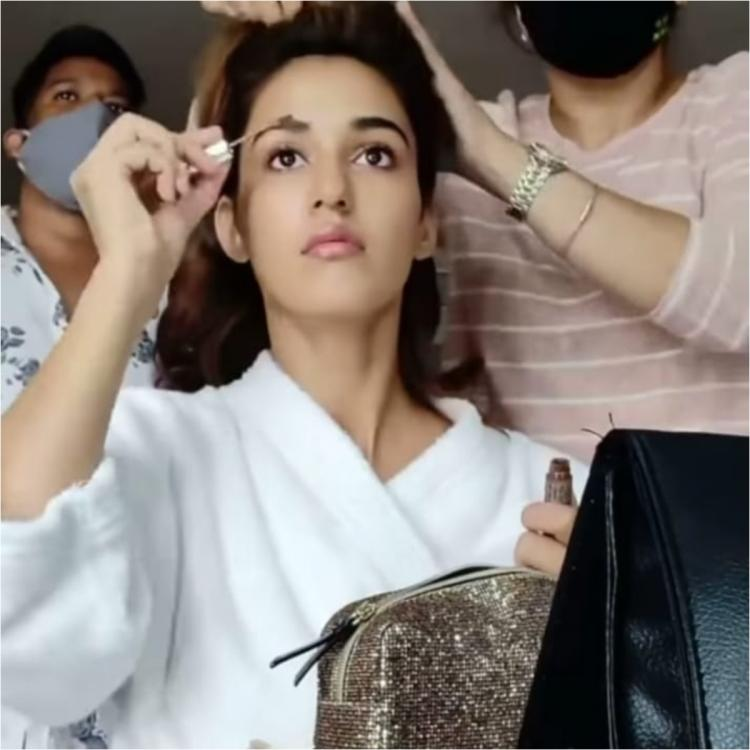 Disha Patani glams up for the day as she turns makeup artist for herself for a shoot; Tiger Shroff REACTS