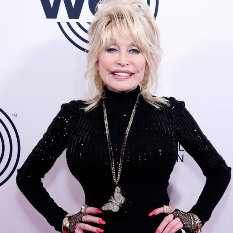 Dolly Parton sings a spinoff to her hit song 'Jolene' before taking Covid vaccine; Urges fans to do the same.