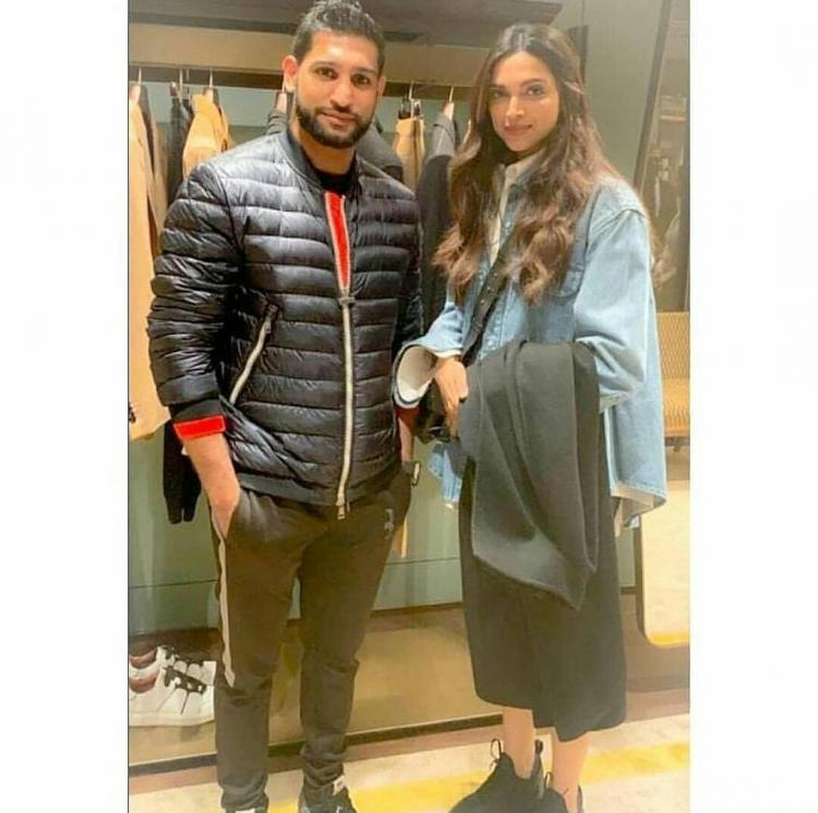 Deepika Padukone is her stunning self as she poses for a picture with British boxer Amir Khan & wife in London