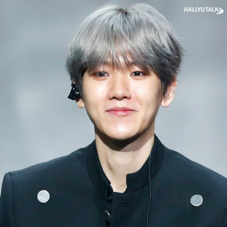 EXO's Baekhyun is smiling at the showcase for the release of the first mini-album City Lights