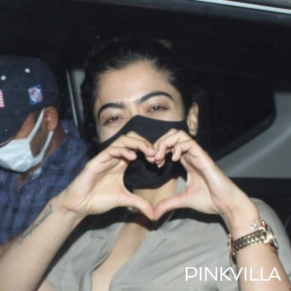 Rashmika Mandanna strikes a hand heart gesture as she is papped arriving at the airport; PHOTOS