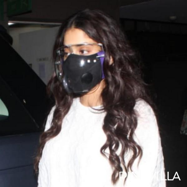 Janhvi Kapoor adheres to Covid 19 safety guidelines at the airport; rocks a comfy white sweater; PICS