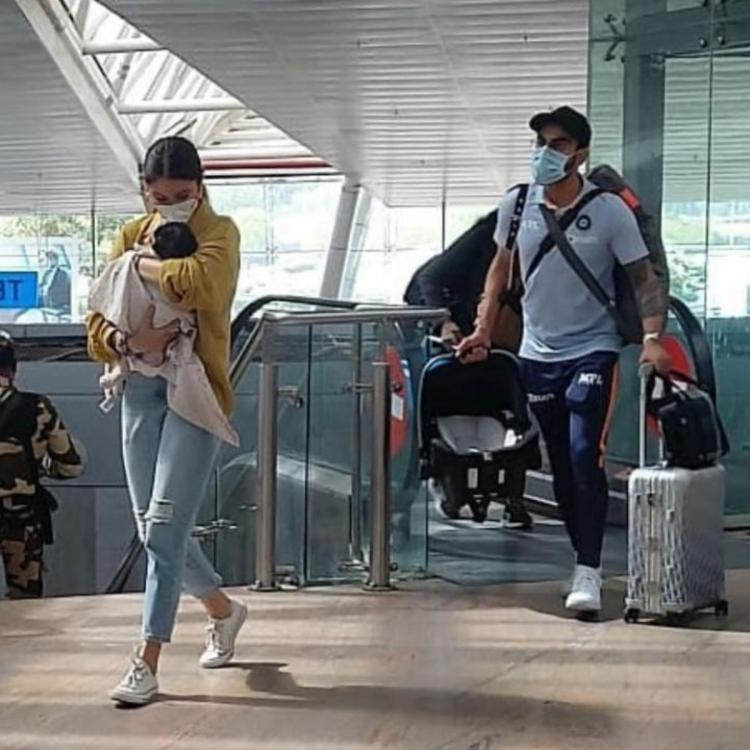 Anushka Sharma holds on to Vamika while Virat Kohli fulfills dad duties as they spotted at Pune airport; PICS