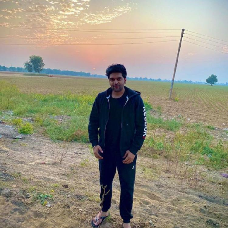 Guru Randhawa finds his bliss among the lush green fields & we can completely relate to him; View PIC