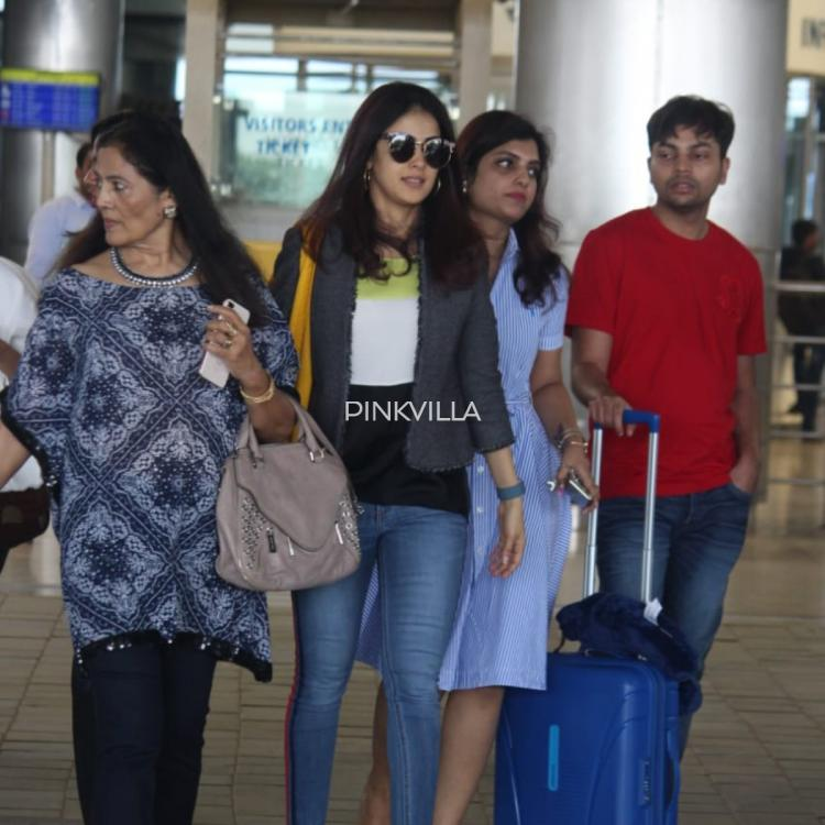 Photos: Genelia D'Souza is all smiles as she gets spotted at Hyderabad airport