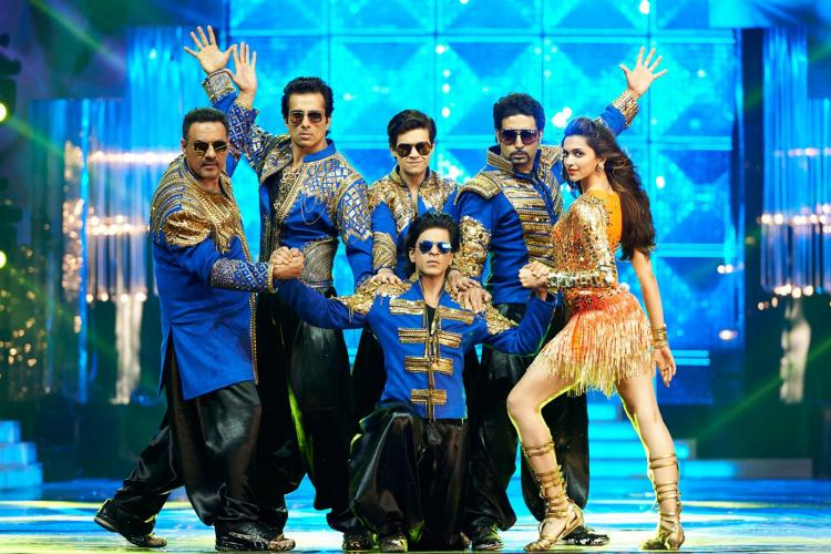 Abhishek Bachchan asks co stars Deepika Padukone, SRK & team Happy New Year to get the band back together